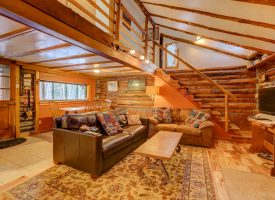 View of living room and upstairs landing of rocky mountain log cabin rental