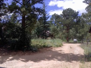 View of Honeymoon Hideout from lower part of driveway as you enter property.