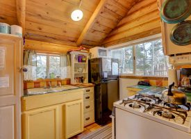 Honeymoon cabin has a full kitchen with appliances